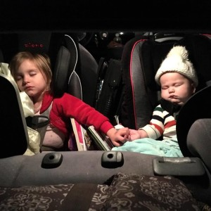My daughter loves holding her little brother's hand, especially when he's upset in the car.(Christopher Walljasper)